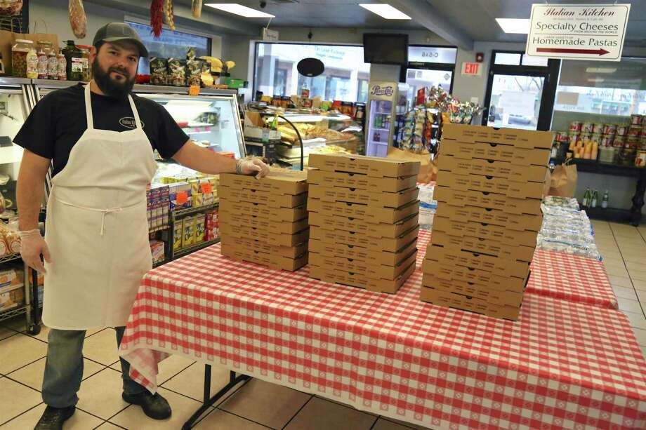 Dominici Giresi, owner of Italian Kitchen, is giving back as well, subsidizing dozens and dozens of pizzas for area hospital workers, seen here in his store on Friday, April 3, 2020. Photo: Jarret Liotta / Jarret Liotta / ©Jarret Liotta 2020