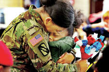 John Badman of The Telegraph won a first place award in the 2019 Illinois Press Association for this photo of Sgt. Kyra Jones, who just returned home from a year-long deployment to Kuwait, giving a hug to her daughter, Raquel, a second grade student at Alton's West Elementary School. The newspaper won 18 awards in this year's competition.