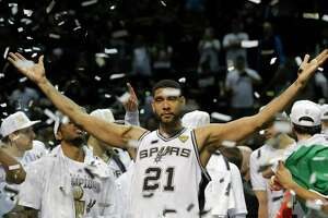 FILE - In this June 15, 2014, file photo, San Antonio Spurs forward Tim Duncan (21) celebrates after Game 5 of the NBA basketball finals in San Antonio. Duncan announced his retirement on Monday, July 11, 2016, after 19 seasons, five championships, two MVP awards and 15 All-Star appearances. It marks the end of an era for the Spurs and the NBA. (AP Photo/David J. Phillip, File)