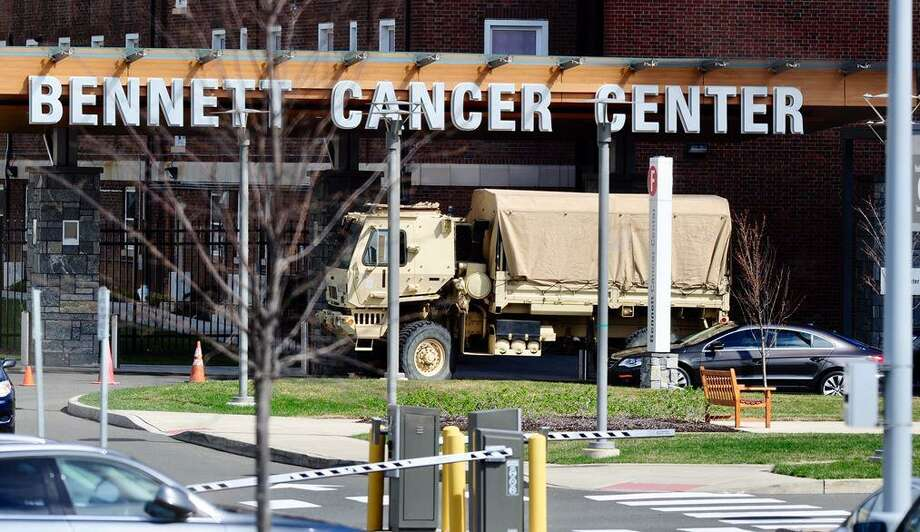 A National Guard truck is seen on the grounds of Stamford Hospital Saturday. Guard personnel were in Stamford to help prepare the Wheeler Building on the hospital campus for extra needs brought on by the coronavirus pandemic. Photo: Matt Brown / Hearst Connecticut Media