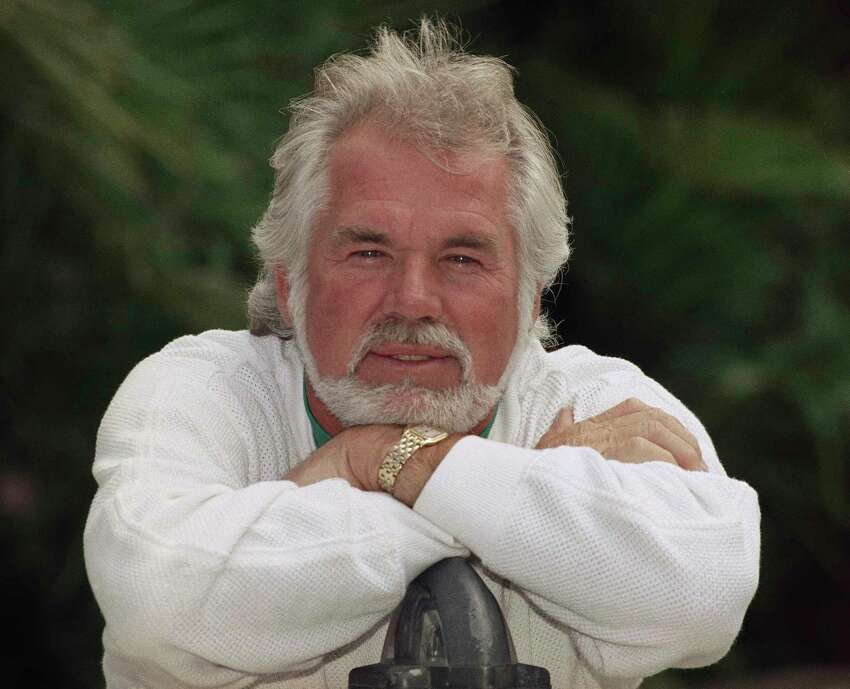 FILE - This May 17, 1989 file photo shows Kenny Rogers posing for a portrait in Los Angeles. Rogers, who embodied a€œThe Gamblera€ persona and whose musical career spanned jazz, folk, country and pop, has died at 81. A representative says Rogers died at home in Georgia on Friday, March 20, 2020. (AP Photo/Bob Galbraith, File)