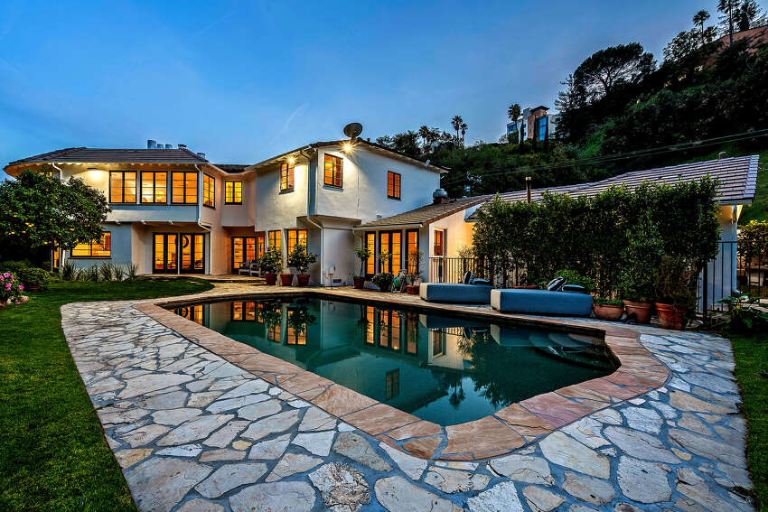 Late Los Angeles Lakers owner Jerry Buss sold the estate in Los Angeles' Bel-Air neighborhood in 1984 for $775,000. It's now up for sale at $5.8 million. The Georgian-style two-story sits on a double lot with a tennis court and a swimming pool. (Amalfi Estates/TNS)
