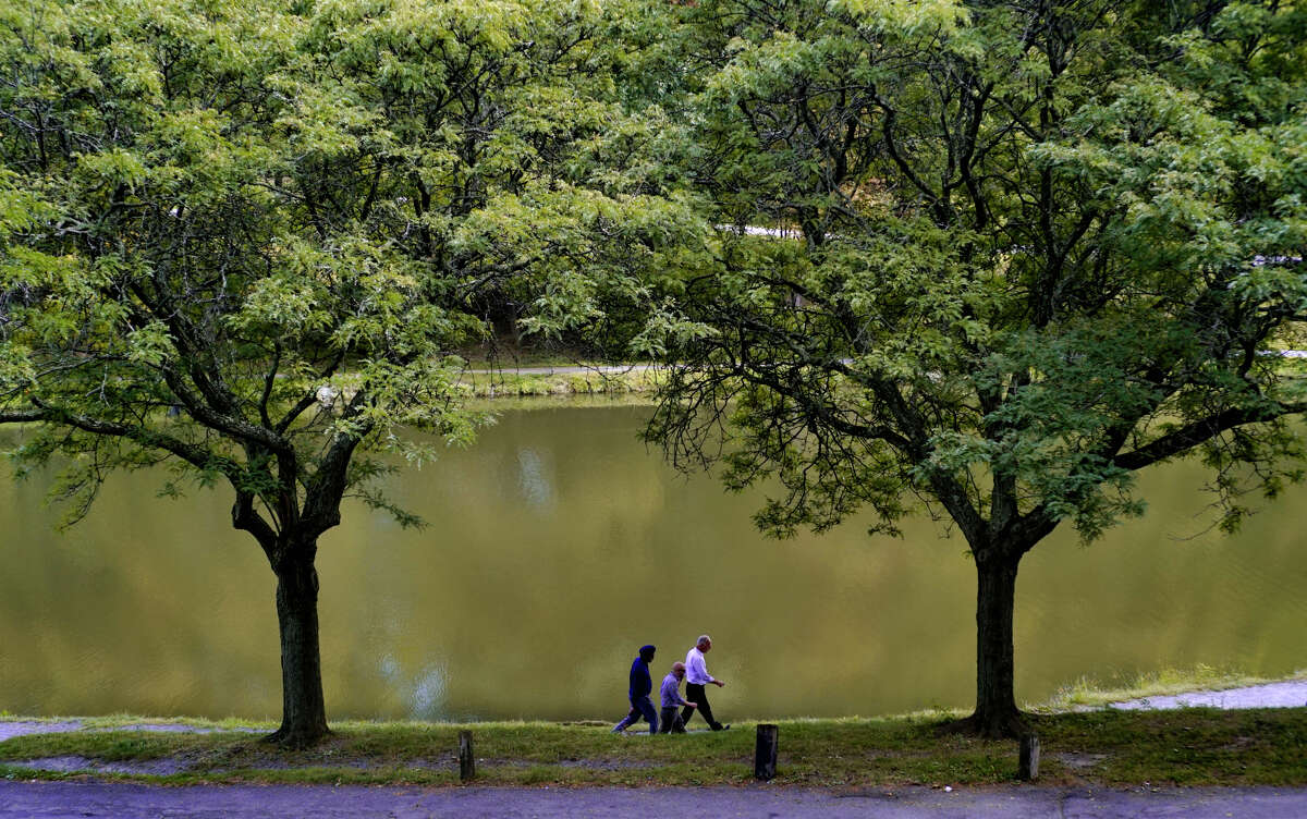 People make their way through Washington Park on Monday, Sept. 9, 2019, in Albany, N.Y.A (Paul Buckowski/Times Union)