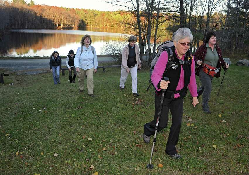Dorothy Surprise, foreground, leads a group of people for a walk in Grafton Lakes State Park as part of a meetup on Wednesday, Nov. 4, 2015 in Grafton, N.Y. (Lori Van Buren / Times Union)