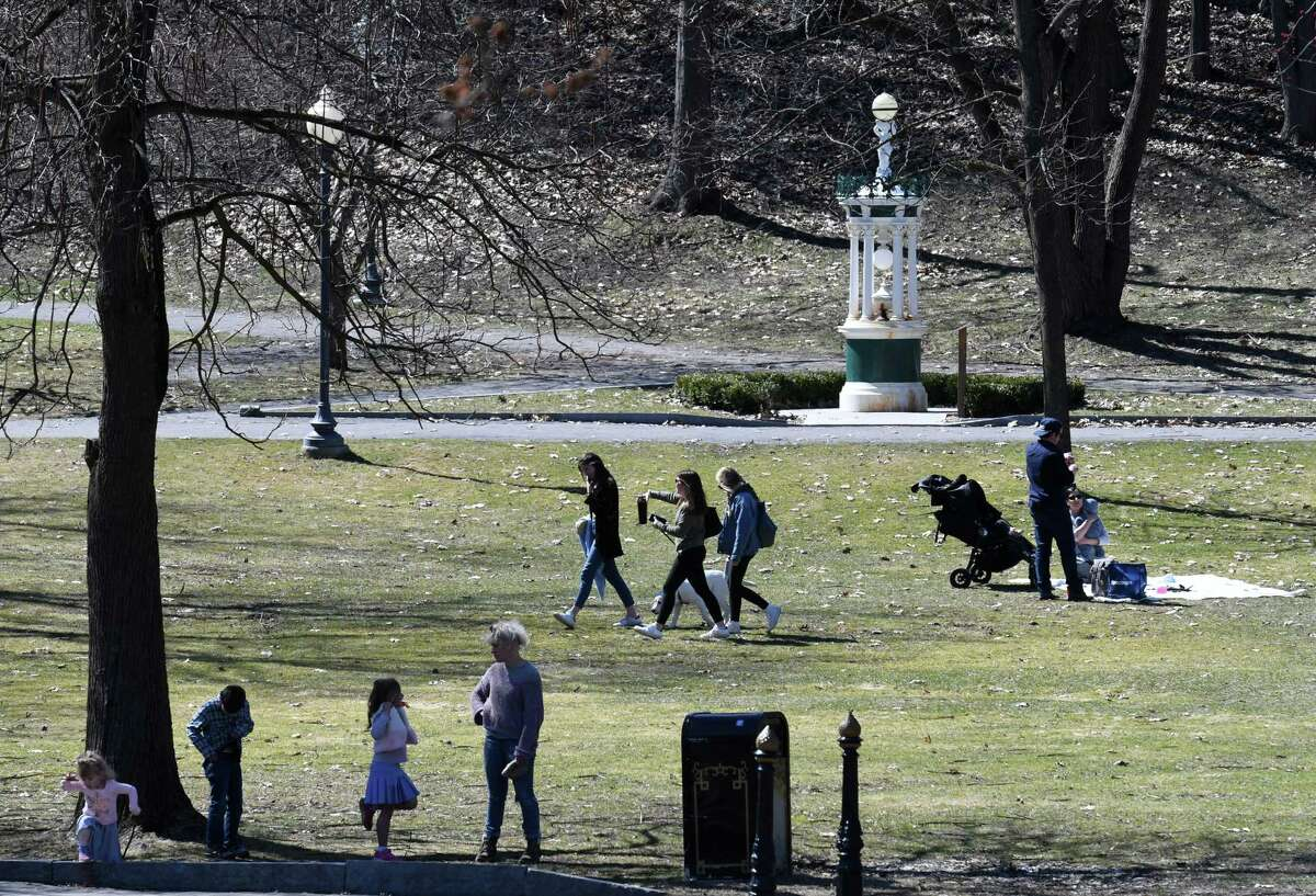 Saratoga's Congress Park remains a popular sunny day destination, as park goers do what they can to keep safe distance during the coronavirus outbreak on Friday, March 27, 2020, in Saratoga Springs, N.Y. (Will Waldron/Times Union)
