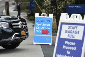 File photo of a a sign for the coronavirus specimen collection site at Greenwich Hospital in Greenwich, Conn., taken Tuesday, March 31, 2020.
