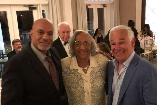 Mary Roman with her son, Craig, left, and former Major League Baseball manager Bobby Valentine. Roman, a longtime Norwalk resident who overcame childhood polio to become a world-class senior Olympian, died Monday from the coronavirus.