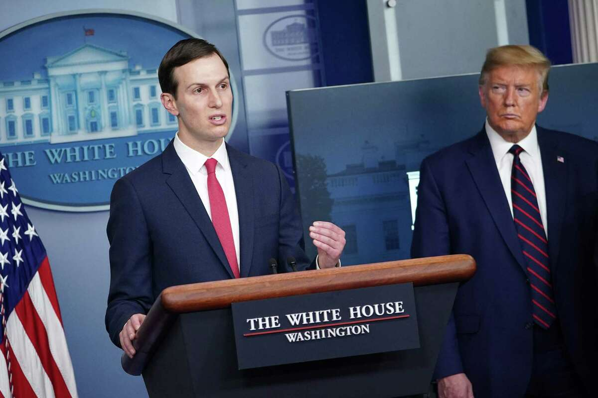 Senior Advisor to the President Jared Kushner (L) speaks, flanked by US President Donald Trump, during the daily briefing on the novel coronavirus, COVID-19, in the Brady Briefing Room at the White House on April 2, 2020, in Washington, DC.