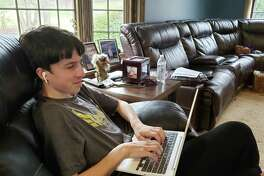 Adam Fox, a Danbury High School senior, works on one of his AP courses at home. Friday, April 3, 2020