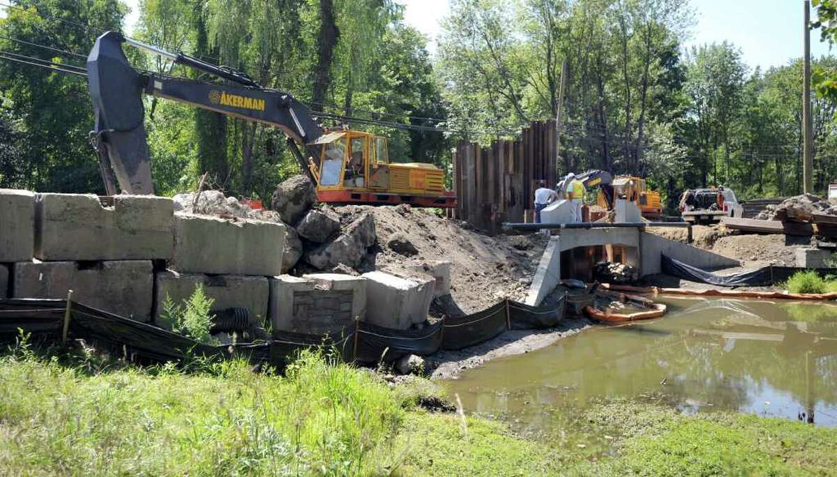 Work is continuing on the rebuilding of the Backus Avenue bridge near the post office in Danbury. The bridge is expected to be open for traffic by the end of October or early November. Photo taken Thursday, August 19, 2010.