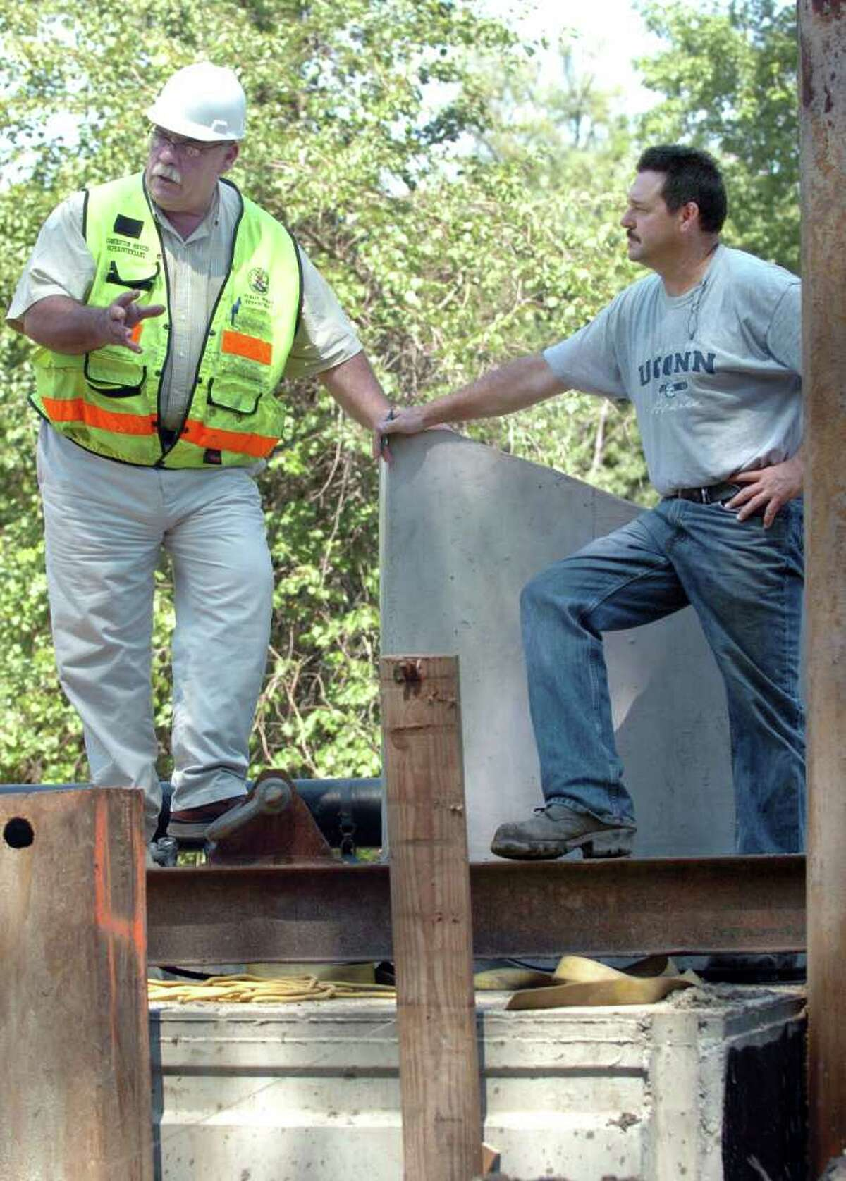 Tom Hughes, left, superintendent of construction services for the city, talks with Robert Brady, general supervisor for Hemlock Construction, the contractor for the Backus Avenue bridge project. Photo taken Thursday, August 19, 2010.