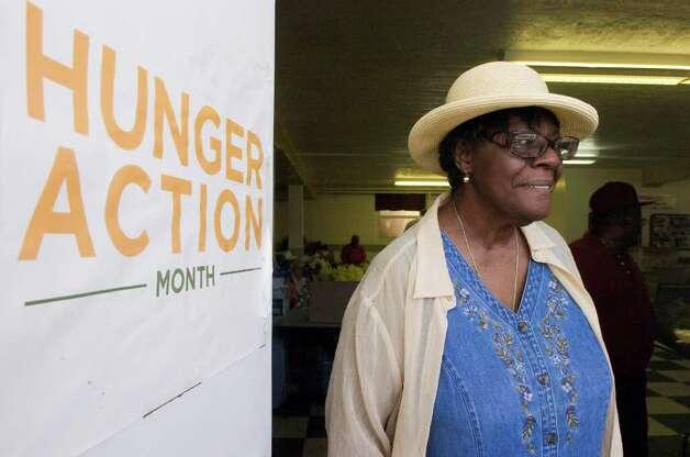 Pantry coordinator Joyce Gumbus prepares to open the Wilson