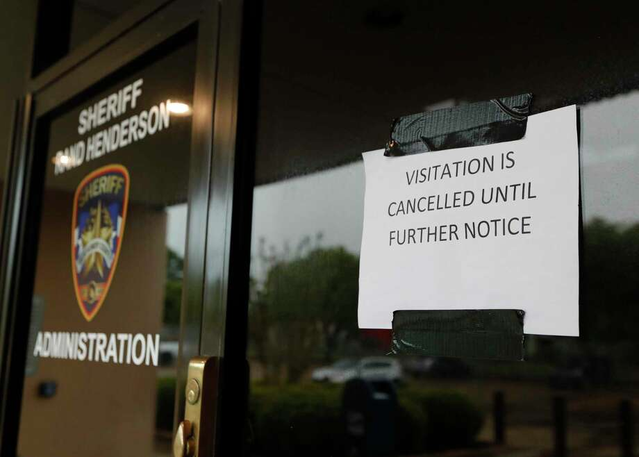 A notice that visitations are cancelled until further notice is posted on the entrance to the Montgomery County Jail and Law Enforcement Center, Saturday, April 4, 2020, in Conroe. An inmate in the Montgomery County Jail has tested positive for COVID-19 two days after giving birth to a baby girl, according to the Montgomery County Sheriff's Office. Photo: Jason Fochtman, Houston Chronicle / Staff Photographer / 2020 © Houston Chronicle