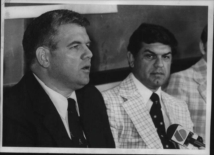 Mike Addesa, new head hockey coach at RPI, speaks to media as Robert F Ducatte, athletic director at RPI College in New York, looks on. Undated (Bud Hewig/Times Union Archive)