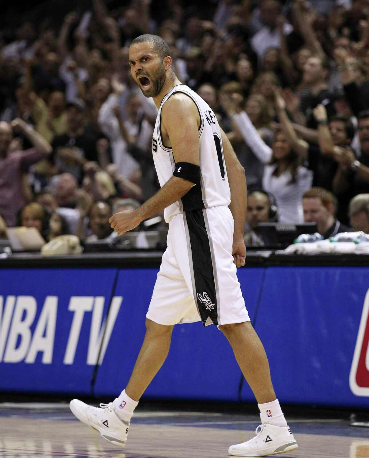 Spurs' Tony Parker (09) reacts after hitting a jump shot against the Dallas Mavericks in the second half of Game 5 of the first round of the Western Conference playoffs at the AT&T Center on Wednesday, Apr. 30, 2014. Spurs defeated the Mavericks, 109-103. (Kin Man Hui/San Antonio Express-News)