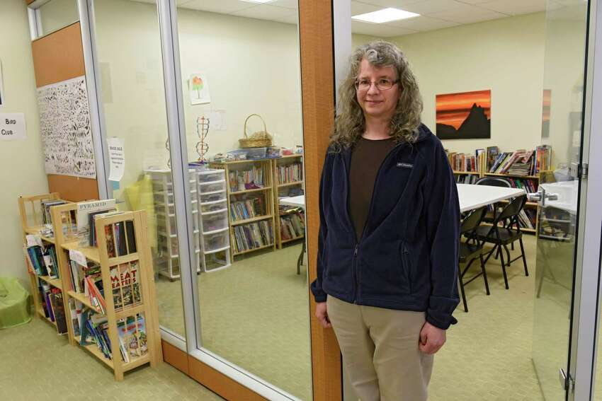Jeannette Roundy stands in the doorway of the art room at Yacon Village, the homeschool community center she created on Friday, April 3, 2020 in Albany, N.Y. (Lori Van Buren/Times Union)