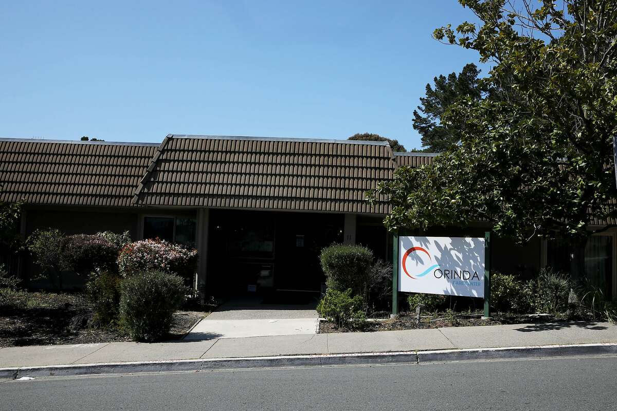 """Exterior of the Orinda Care Center, located at 11 Altarinda Rd., on Friday, April 3, 2020, in Orinda, Calif. Contra Costa officials release more info on outbreak at nursing facility, launch investigations into two more facilities: At least 27 people who live or work at a 45-resident nursing facility in Orinda have tested positive for the coronavirus, health officials said Friday as they launched investigations and started testing at two other senior care facilities in the county. Officials started investigating the Orinda Care Center this week when two staffers sought sought medical care, according to the county Health Services. The two staffers and two patients tested positive on Wednesday. County health officials tested all patients and staff Thursday, they said, and confirmed 24 patients and three staffers had the virus. They are still awaiting some test results. Two of the residents are being treated at hospitals. As of Friday morning, no staffers or patients had died of the virus. Staffers and residents who do not have serious symptoms are medically isolated but not hospitalized, officials said. """"The situation is very serious, and we are deeply concerned about residents of our senior care facilities in Contra Costa County,"""" said Dr. Chris Farnitano, the county's health officer. """"That is why we need everyone to follow the stay-at-home order, social distancing guidance and other measures in recent health orders ? to protect the people in our community who are vulnerable to severe illness from COVID-19."""""""