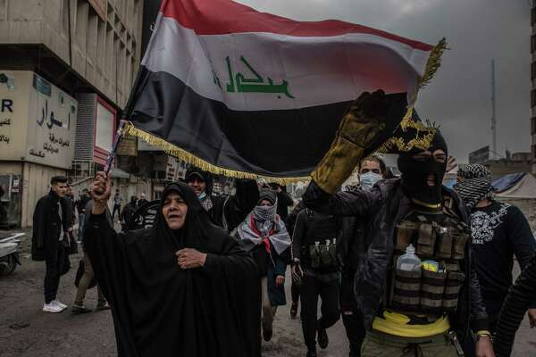 Iraqi protesters march toward Khilani Square in Baghdad in January.