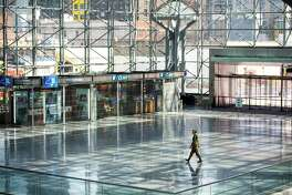 A soldier walks the Javits Center lobby on April 1.
