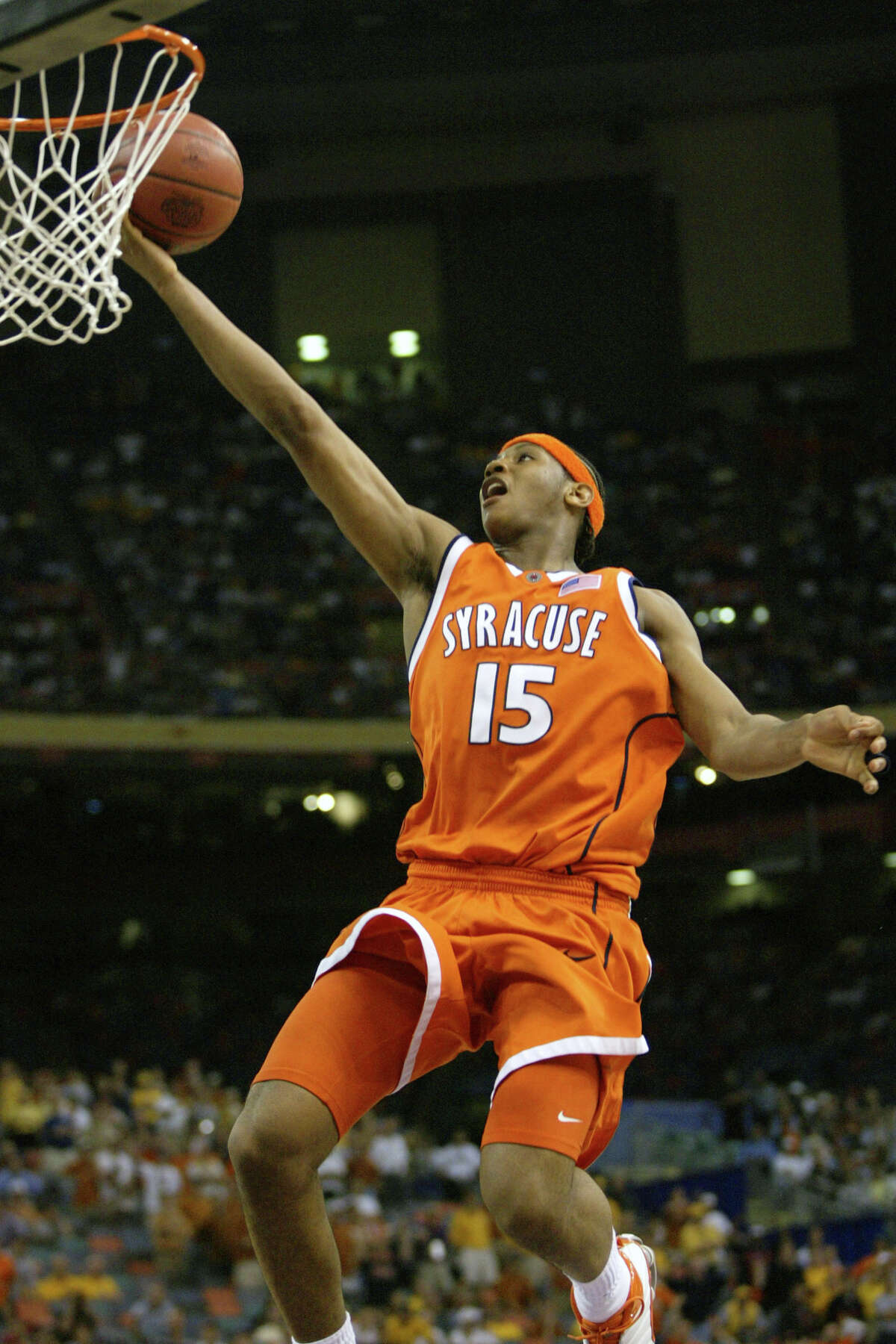FILE - In this April 5, 2003, file photo, Syracuse's Carmelo Anthony puts up a layup in the closing seconds of the Orangemen's 95-84 win over Texas in the semifinals of the Final Four in New Orleans. Anthony averaged 26.5 points and 12 rebounds per game in the 2003 Final Four. The only first-year players ever to be named the most outstanding player of a Final Four are Anthony Davis, Carmelo Anthony and Dukea€™s Tyus Jones in 2015. (AP Photo/Michael Conroy, File)