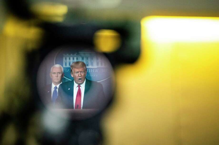 President Trump, reflected in a television camera, speaks with his coronavirus task force at a White House briefing on March 18., 2020. Photo: Washington Post Photo By Jabin Botsford. / The Washington Post