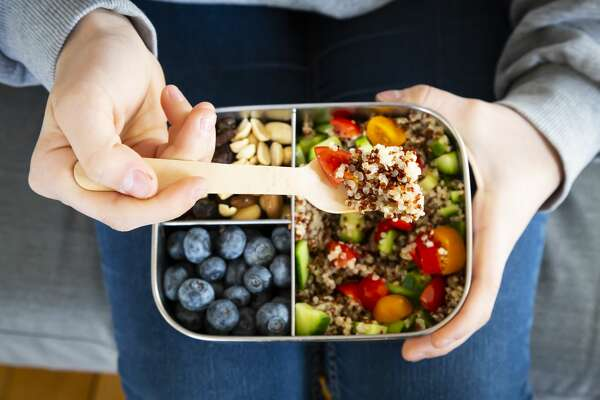 A file photo of a lunch box filled with fruits and a quinoa salad.
