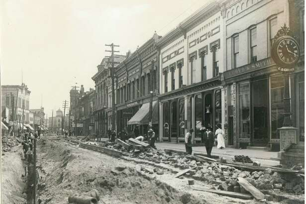 This photo shows construction work taking place in downtown Manistee in the very early 1900s.