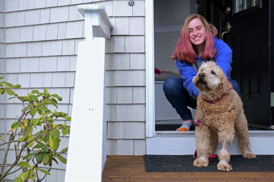 Julianna Shmaruk, a freshman at Lafayette College, is back in Westport with her dog Ronan, on April 4, 2020. Photo: Jarret Liotta / For Hearst Connecticut Media / Jarret Liotta / ©Jarret Liotta 2020