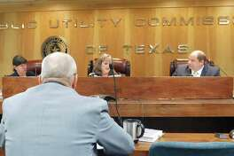 Public Utility Commissioners hear information from Stephen Journeay, director of the PUC's Office of Policy and Docket Management, during a meeting last year on July 18, 2019. Commissioners are from left, Commissioner Shelly Botkin, Chairman DeAnn Walker, and Commissioner Arthur D'Andrea.
