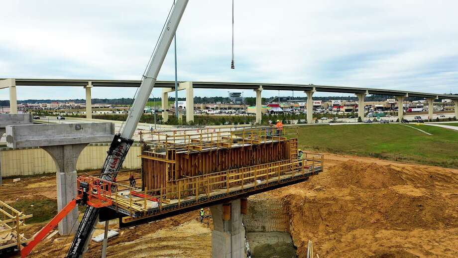 Bridge crews work on a column just east of the IH 69 northbound frontage road. GPI continues to work on the 184-mile Grand Parkway highway project and remains on schedule. Photo: Courtesy Of GPI