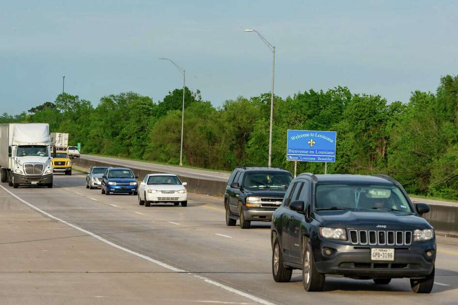 Traffic signs along I-10 advise travelers of the impending travel restrictions on Sunday evening. Texas governor Greg Abbott ordered that all personal travel from Louisiana must be quarantined for 14 days before being admitted to the state as of noon, March 30, 2020. Photo made on March 29, 2020. Fran Ruchalski/The Enterprise
