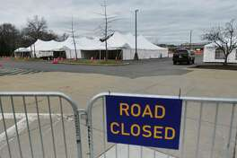 Work continues as a COVID-19 drive-through testing site is set up at the University at Albany on Sunday, April 5, 2020, in Albany, N.Y. The testing site will start up on Monday and is only for those who make appointments beforehand. (Paul Buckowski/Times Union)
