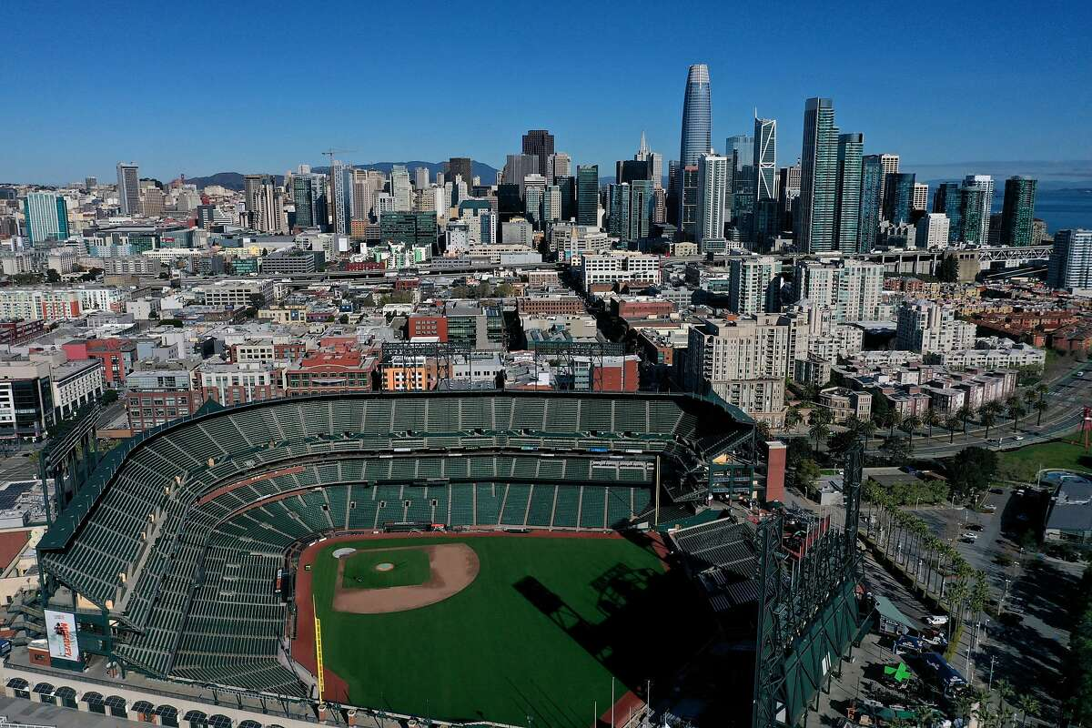 """SAN FRANCISCO, CALIFORNIA - MARCH 26: An aerial view from a drone shows Oracle Park, home of the San Francisco Giants, empty on Opening Day March 26, 2020 in San Francisco, California. Major League Baseball Commissioner Rob Manfred recently said the league is """"probably not gonna be able to"""" play a full 162 game regular season. (Photo by Justin Sullivan/Getty Images)"""