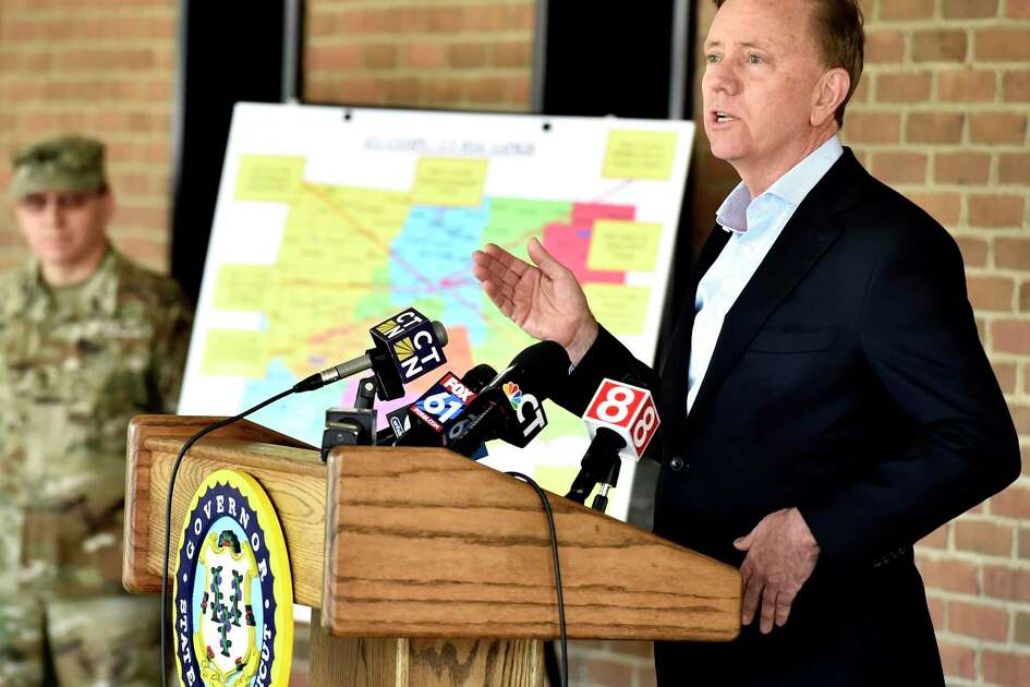 Gov. Ned Lamont, right, at a press conference Wednesday in New Haven.