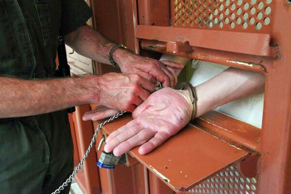 A prisoner at the Pelican Bay State Prison, the state's toughest correctional institution, has his hands shackled before his cell door is opened, near Crescent City, Calif., Feb. 9, 2012. (Jim Wilson/The New York Times archive)