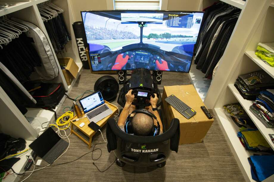 IndyCar driver Tony Kanaan, of Brazil, practices on his racing simulator in his home in Indianapolis, Saturday, March 28, 2020. Photo: AP Photo/Michael Conroy / Copyright 2020 The Associated Press. All rights reserved.
