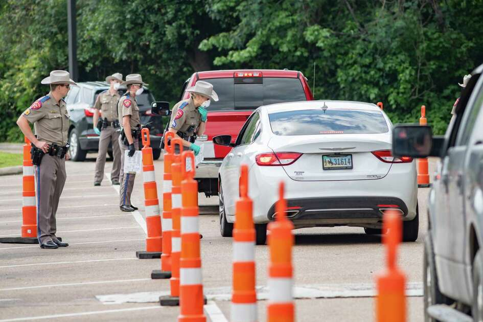 DPS Troopers set up a traffic stop for motorists crossing the border between Louisiana and Texas on I-10 at the Texas Welcome Center in Orange, TX to determine if they needed to be quarantined from entering the state on April 5, 2020 according to the governor's order. Fran Ruchalski/The Enterprise