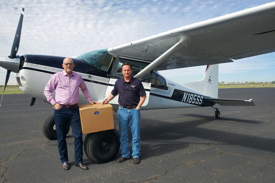 Bryan Rose, left, president and CEO of RoseText Inc., and Scott Gloyna, wing leader from Angel Flight South Central, flew masks and other supplies to Ward Memorial Hospital. Photo: Courtesy Photo