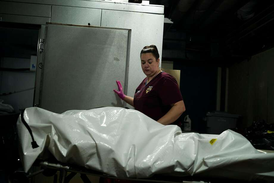 Lina Evans, the coroner of Shelby County, Ala., receives a body at the Shelby Baptist Medical Center morgue in Alabaster, April 2, 2020. Inconsistent protocols, limited resources and a patchwork of decision-making has led to an undercounting of people with the coronavirus who have died, health experts say. (Bob Miller/The New York Times) Photo: Bob Miller, NYT