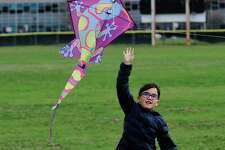 Mateo Moha, 7 of Stamford releases a kite while enjoying some fresh air and exercise with his father Sabastian Moha and brother Franco Moha, 10, at Scalzi Park in Stamford, Connecticut on April 2, 2020. His mother, Karen Numez, said she is concerned with keeping her sons occupied during Stamford's spring break.