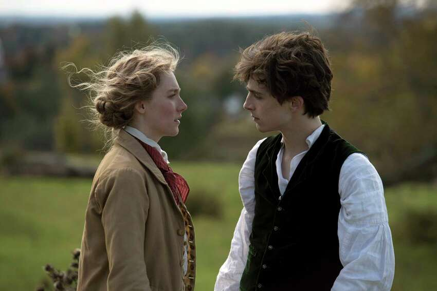 This image released by Sony Pictures shows, Saoirse Ronan and TimothA©e Chalamet in a scene from