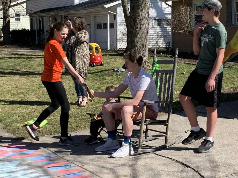 "Scenes from Danny TerBurgh's 16th birthday ""parade"" on Love Street in Midland on Sunday afternoon, April 5, 2020. Well-wishers drove past the TerBurgh household and treated Danny to oodles of candy, some toilet paper, a couple of brand new basketballs, and even an impressive tire burnout. Photo: Fred Kelly/fred.kelly@mdn.net"