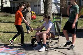 "Scenes from Danny TerBurgh's 16th birthday ""parade"" on Love Street in Midland on Sunday afternoon, April 5, 2020. Well-wishers drove past the TerBurgh household and treated Danny to oodles of candy, some toilet paper, a couple of brand new basketballs, and even an impressive tire burnout."
