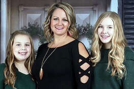 Dr. Briana Oller, center, with her daughters Zoe, left, and Sami. Briana is currently recovering at home from the coronavirus.