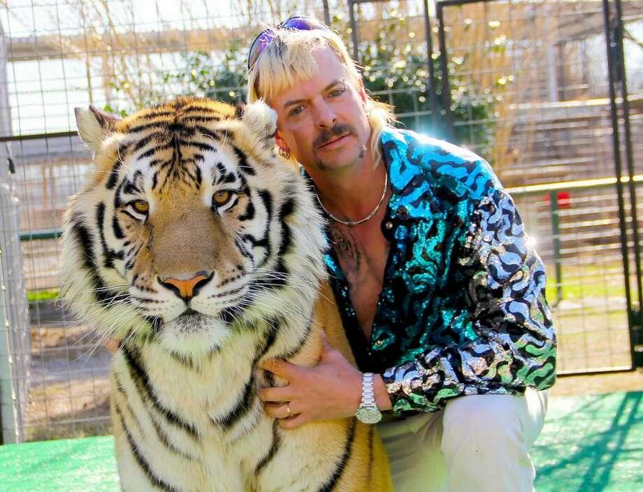 Joseph Maldonado-Passage, aka Joe Exotic, with one of his tigers. Photo: Courtesy Netflix