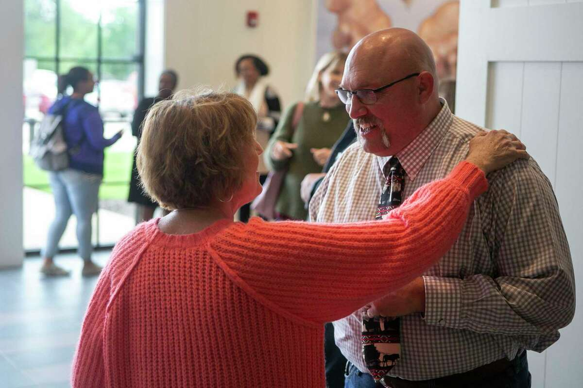 The Rev. Frank Pomeroy greets congregants after Sunday morning service at First Baptist Church in Sutherland Springs, Texas, April 5, 2020. First Baptist Church is the site of the deadliest mass shooting in Texas and its survivors have taken different approaches to church attendance in the age of COVID-19. Church services have continued, despite CDC guidance to not have more than 10 people in a gathering, but congregants have the option to live stream the service from home. Pastor Frank Pomeroy said if the government forced the church to close its physical doors, he would file a constitutional lawsuit.