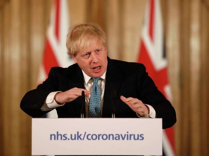 FILE - In this Tuesday, March 17, 2020 file photo British Prime Minister Boris Johnson gestures as he gives a press conference about the ongoing situation with the COVID-19 coronavirus outbreak inside 10 Downing Street in London. British Prime Minister Boris Johnson has been admitted to a hospital with the coronavirus. Johnson's office says he is being admitted for tests because he still has symptoms 10 days after testing positive for the virus.(AP Photo/Matt Dunham, File)
