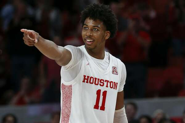 Houston Cougars guard Nate Hinton (11) celebrates after dunking the ball against the UCF Knights during the second half of an NCAA game at the Fertitta Center Friday, Jan. 3, 2020, in Houston. The Cougars won 78-63.