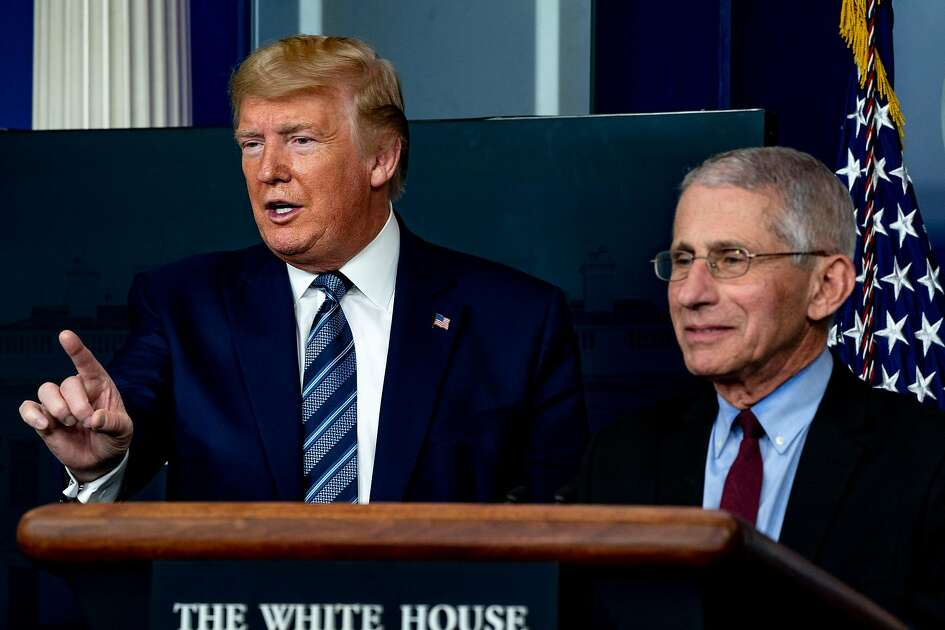 President Donald Trump speaks with Anthony Fauci, director of the National Institute of Allergy and Infectious Diseases, during a coronavirus briefing at the White House in Washington, April 5, 2020. (Anna Moneymaker/The New York Times)