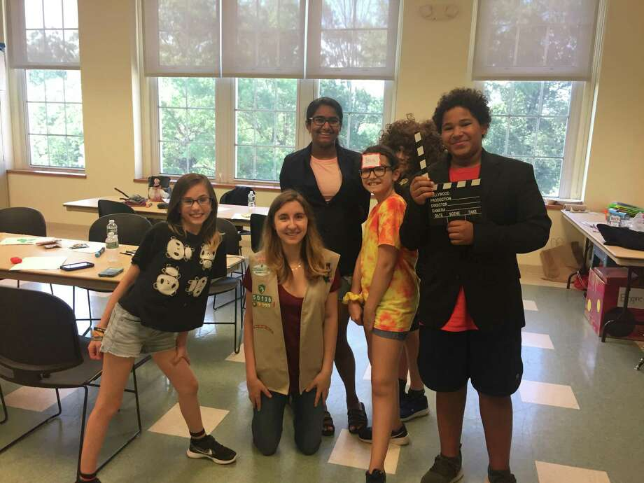 Local Girl Scout Elizabeth Casolo teaches a lesson in the significance of digital media education to Greenwich middle school students. Casolo, a Greenwich High School junior, is working toward achieving her Gold Award, a prestigious honor for Girl Scouts. Photo: Contributed /